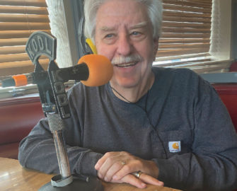 Radio personality Al Wynn hosts the Coffee Break show from his familiar spot at Cousins' Restaurant in The Dalles.