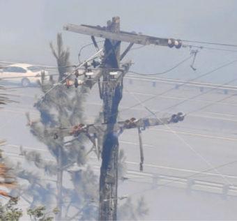 utility pole burning