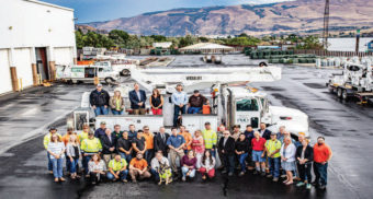 Northern Wasco PUD team outside in front of bucket truck