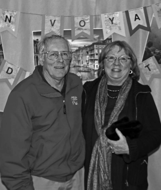 Director Clay Smith poses at a PUD retirement party with his wife, Karen.
