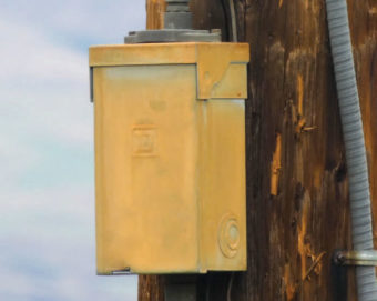 Yellow box on the power pole.