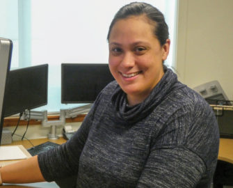 Neticia Fanene sitting at desk