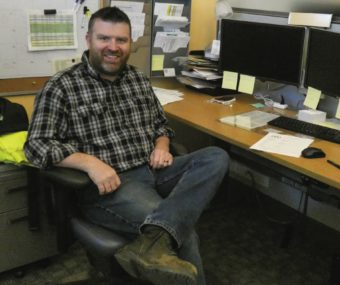 Photo of Joshua Smith at his desk