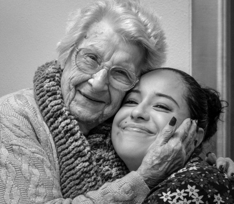 Veronica Quintero hugs resident Eva Phelps