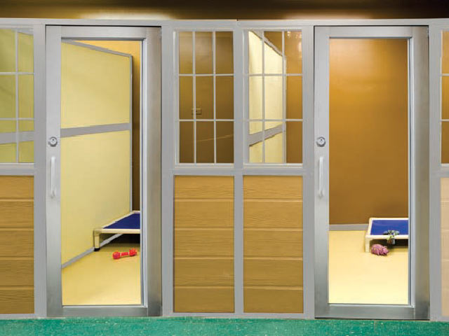 Glass doors and bright colors make for friendlier interaction between animals and humans in this example of a kennel suite similar to what Home at Last supporters envision for the animal shelter. Photo provided by Morgan Co.