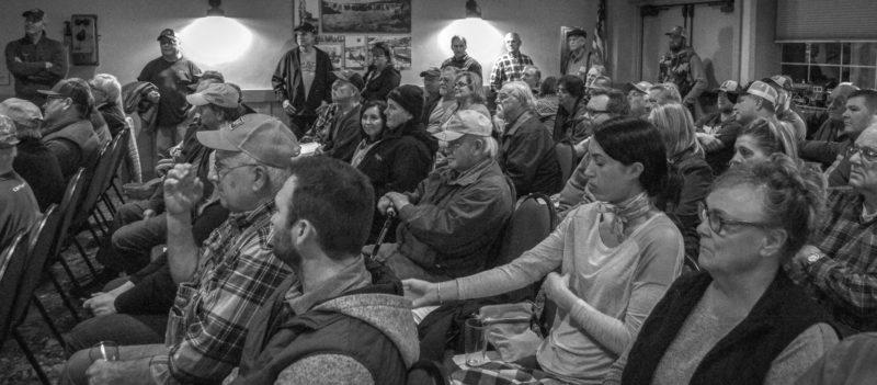 crowd of people in a meeting room