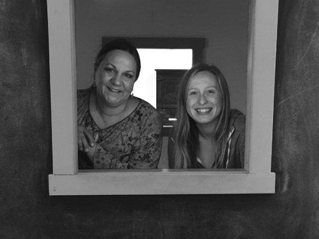 Micah Steinbeck, left, and Montana Ferres, pose in the playhouse window at WonderWorks Children's Museum.