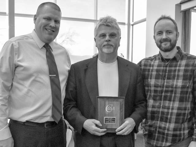 Athletic Director Mike Somnis, left, and Assistant Principal Kurt Evans, right, join Nick in celebrating his 2017 Oregon high school principal of the year honors.